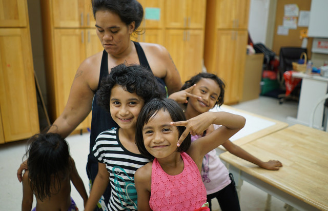 Shari Kamaka with some of her kids, from left, Bryanna Kenan, 3, Yosia Kenan, 9, Shentia Kenan, 6, and right, Pedtina Kenan, 7, at the Institute of Human Services women's shelter.