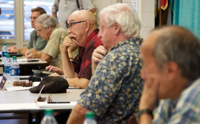 Staff and members of the state Public Utilities Commission listen to testimony, Sept. 4.
