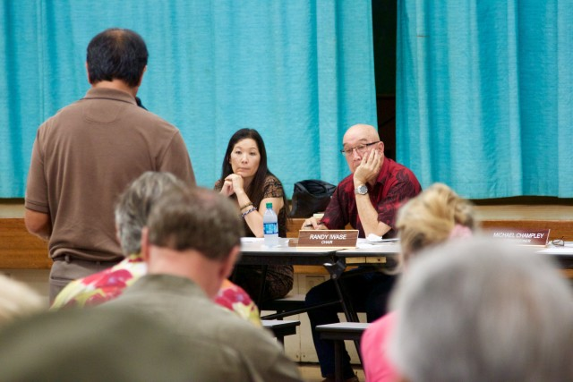 PUC Chair Randy Iwase, right, and Commissioner Lorraine Akiba listen to a person comment on the prosed NextEra-HEI merger during a meeting on Maui, Sept. 4.