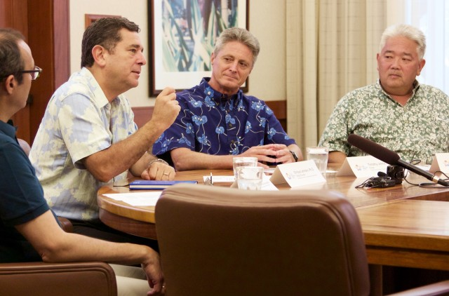 The International Union for Conservation of Nature's global director, Enrique Lahmann, answers a question Wednesday about Hawaii's preparations to host the World Conservation Congress next September. Also pictured, from right, are Randall Tanaka, WCN executive director, Timothy Johns, WCC National Host Committee chair, and Ricardo Tejada, IUCN director of global communications.