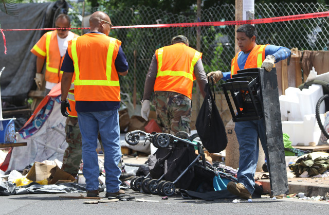 Honolulu City and County workers clean up trash near the intersection of Keawe Street and Ilalo part of the citys sweep in Kakaako. 21 sept 2015. photograph Cory Lum/Civil Beat