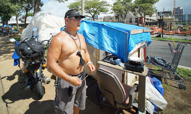 Steve Young stands near his scooter near the intersection of Ilalo and Keawe streets -- the site of a Sept. 17 sweep.