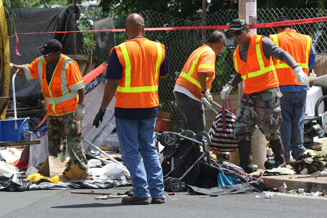 City and country workers remove trash and other debris along Keawe Street and Ilalo Street on monday's sweep of Kakaako. 21 sept 2015. photograph Cory Lum/Civil Beat