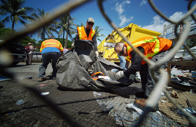 City and County workers load trucks with large pieces of trash along Ohe Street as part of the city's homeless cleanup in Kakaako. 8 sept 2015. photograph Cory Lum/Civil Beat