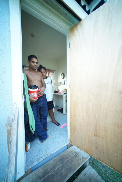 Residents left, Augustine Pannell and right, Marie Kane stand in the doorway of the micro home located at St. Elizabeth's Episcopal Church parking lot.  homeless. 20 sept 2015. photograph Cory Lum/Civil Beat