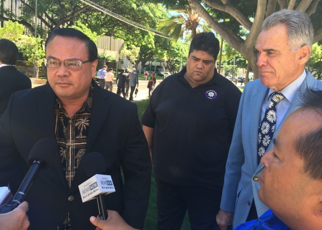 Kelii Akina of the Grassroot Institute of Hawaii and attorney Michael Lilly outside District Court earlier this fall, seeking to halt Nai Aupuni's election.