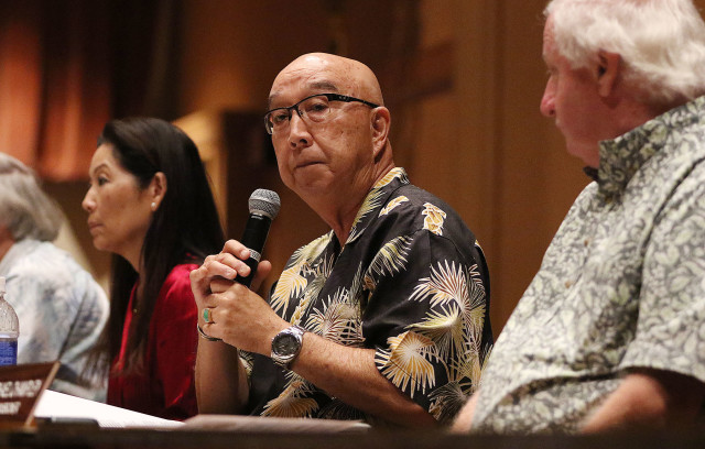 Hawaii Public Utilities Commission Chair Randy Iwase and left, Commissioner Lorraine Akiba, right Commissioner Michael Champley listen to public testimony at McKinley HS on the proposed NextEra Energy/Hawaiian Electric Industries merger. 27 oct 2015. photograph Cory Lum/Civil Beat