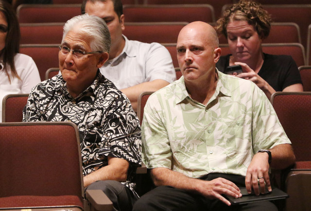 CEO and President of Hawaiian Electric Co. Alan Oshima and NextEra President Eric Gleason sit near the front row of Public Utilities Commission meeting held at McKinley High School auditorium. 27 oct 2015. photograph Cory Lum/Civil Beat