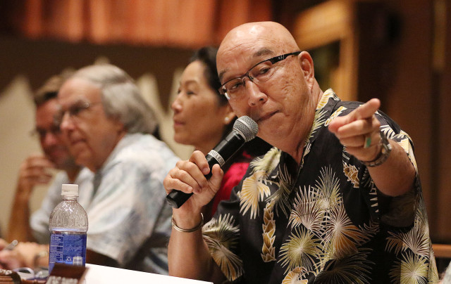 Hawaii Public Utilities Commission Chair Randy Iwase and Lorraine Akiba listen to public testimony at McKinley HS on the proposed NextEra Energy/Hawaiian Electric Industries merger. 27 oct 2015. photograph Cory Lum/Civil Beat