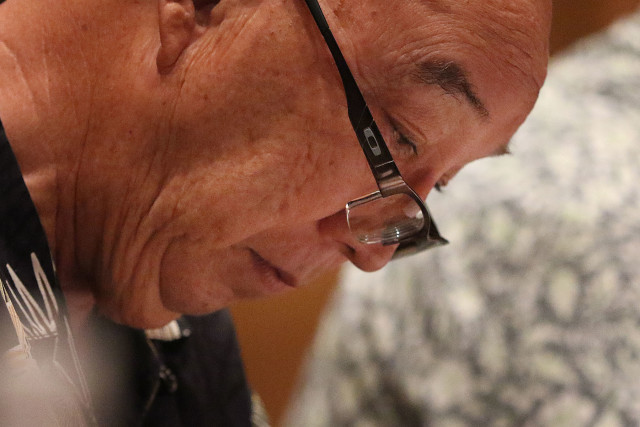 Hawaii Public Utilities Commission Chair Randy Iwase, seen here last month during at hearing on the merger at McKinley High School, will be acting as judge during the evidentiary hearing that starts Monday.