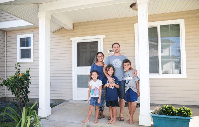 Melissa Jones with her husband Tim and her children Koen, Miles and Lea at their home at the Marine Corps Base Hawaii in Kaneohe. Jones is a plaintiff in a lawsuit urging the developer Forest City to investigate current pesticide risks.