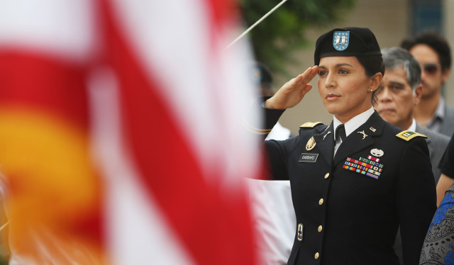 Congresswoman Tulsi Gabbard salutes during the singing of the National Anthem at the National Memorial of the Pacific on Oct. 15.