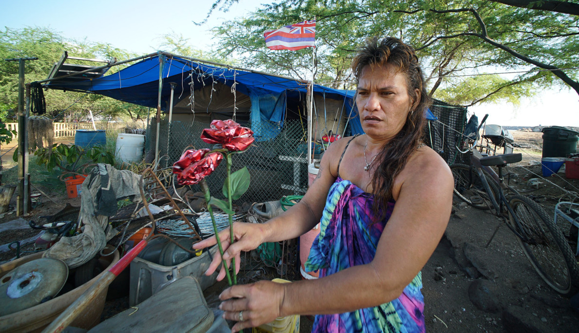 Tita makes a living in part by making crafts from recycled materials found around The Harbor.