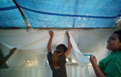 Maelia helps Queenie renovate a camp. The teenagers have learned to be resourceful when it comes to decorating.