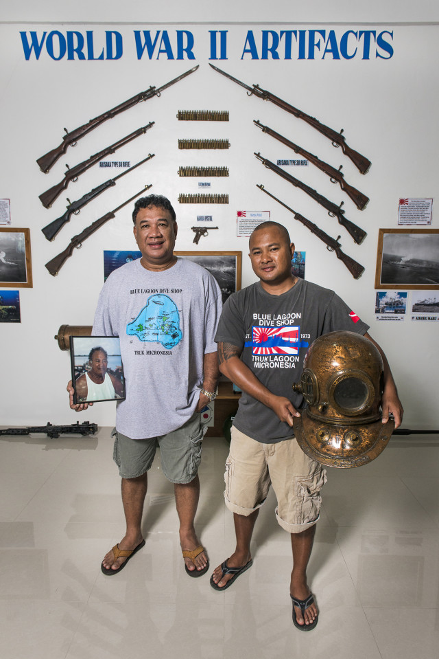 Gradvin Aisek and his son Tryfin Aisek at the Blue Lagoon Resort dive shop museum.