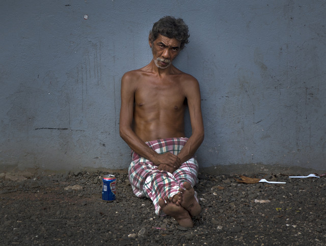 Alcoholism and substance abuse plagues many on the islands. This man was passed out along a street in Pohnpei.