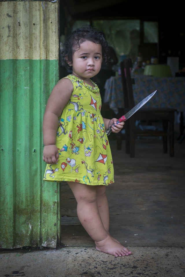 A Chuukese child in Pohnpei. Poverty is pervasive throughout the region and it's hard to see what billions of dollars in federal aid has accomplished.