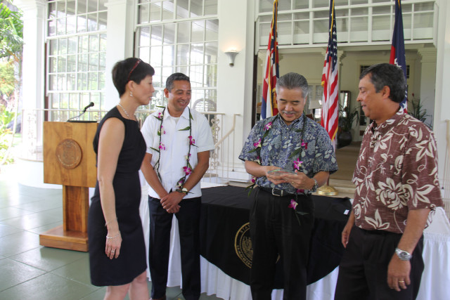 Hawaii Department of Human Services Director Rachael Wong, left, Deputy Director Pankaj Bhanot, right, join Gov. David Ige, center right, and U.S. Department of Agriculture administrator Jesus Mendoza in accepting an award, Wednesday, at the governor's mansion.