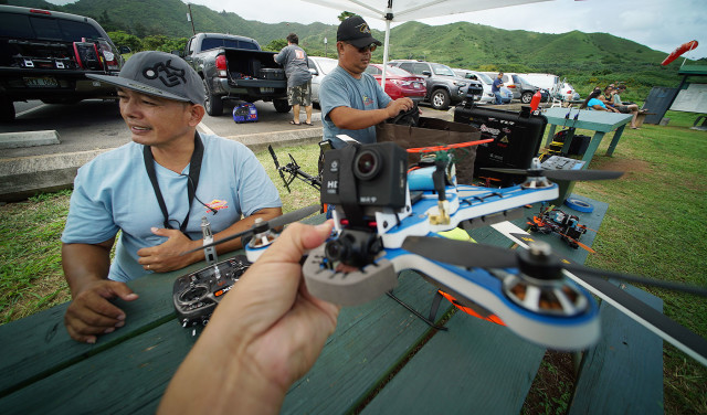 Orlando Paeste sits at table preparing his drones for races held at the Kawainui R/C Air Model Field near Kailua. 7 nov 2015. photograph Cory Lum/Civil Beat