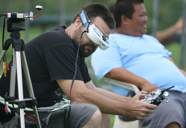 Drone racing pilots wear goggles and use their radio controllers to pilot and fly the small drones around a course at the Kawainui R/C Air Model Field near Kailua. 7 nov 2015. photograph Cory Lum/Civil Beat