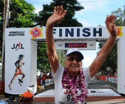 Gladys Burrill crosses a finish line.