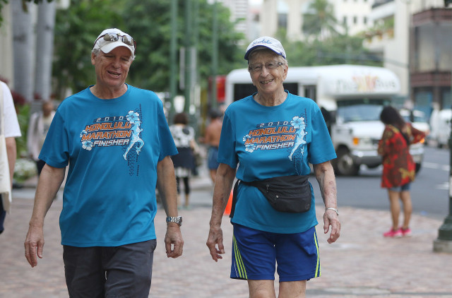 97-year-old Gladys Burrill walks with George McCarthy. 24 nov 2015. photograph Cory Lum/Civil Beat