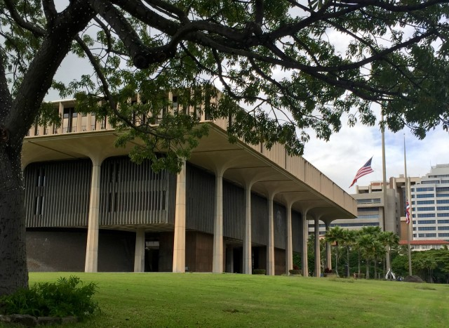 The flag flies at half mast Tuesday outside the Hawaii State Capitol due to the attacks in Paris.