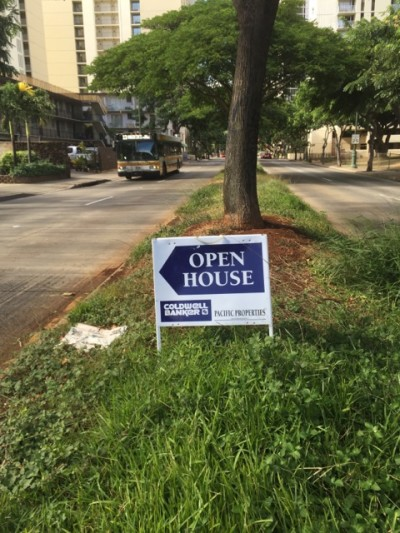 real estate sign illegal median grass strip