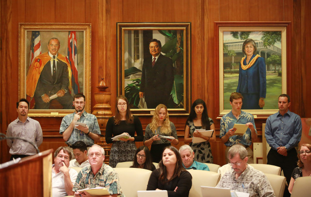 Staff from the Ways and Means committee and legislative staff members crowd the room as Governor David Ige announces the 2017 Executive Supplemental Budget at the Capitol. 21 dec 2015. photograph Cory Lum/Civil Beat