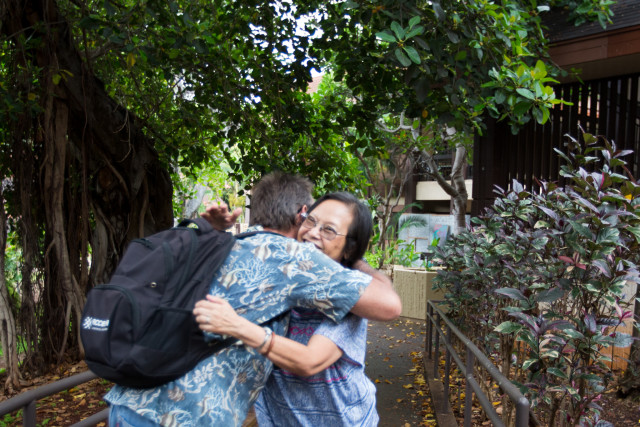 Robert Binnie's math tutor, retired teacher Charlis Lee, greets him on the Kapiolani Community College campus.