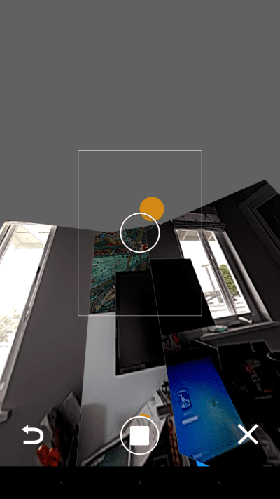 Google's Street View app guides you through the process of capturing a spherical photo with helpful orange dots.