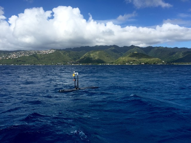 The Wave Glider robot cruises off the coast of east Oahu, collecting ocean data.