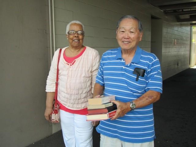 Project Dana volunteer Honest Uyeno takes avid reader Betty Culross, 81, to the library.