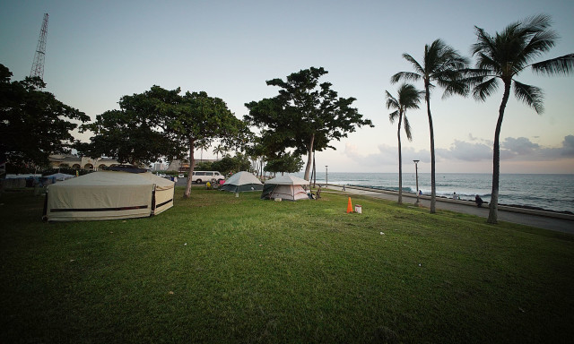 In the latest count, outreach workers found 180 people who were living in tents and makeshift structures at two parks that front the Kakaako shoreline.