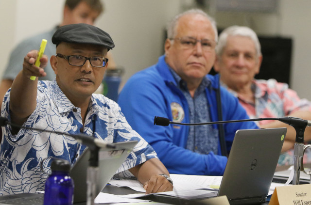 Informational hearing at the Legislature as Senator Will Espero gestures while asking questions about language used by the Dept of Health. 28 dec 2015. photograph by Cory Lum/Civil Beat