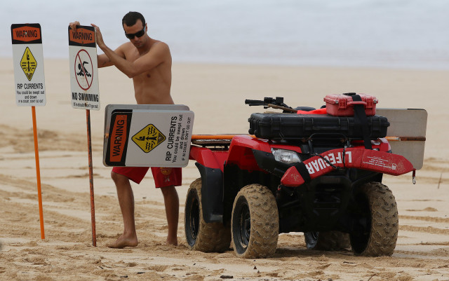 Safety experts say don't swim at beaches where there is no lifeguard. But beefing up the lifeguard system is expensive.