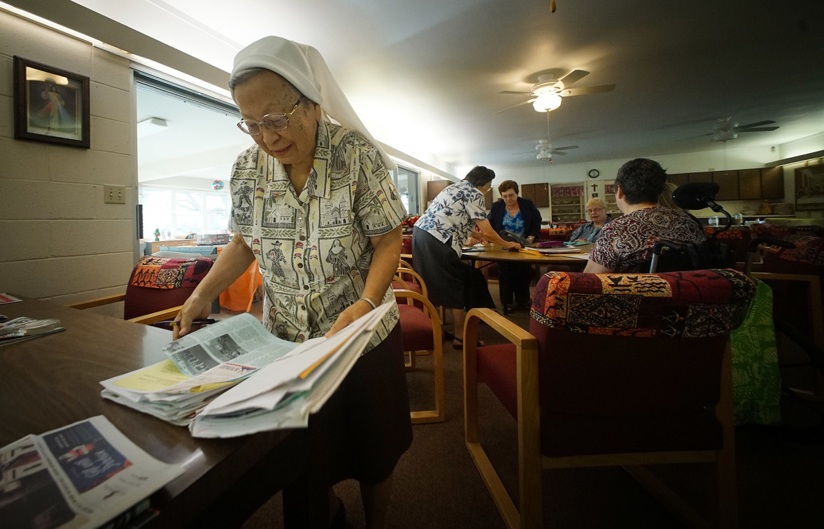 Sister Rose Annette Ahuna shares some clips inside community area at the Saint Francis Convent. 12 dec 2015. photograph Cory Lum/Civil Beat