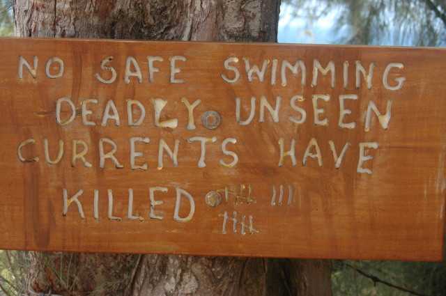 People have taken it upon themselves to make signs like this one to warn hikers of how many people have died, in this case swimming at Hanakapiai Beach on the north shore of Kauai.