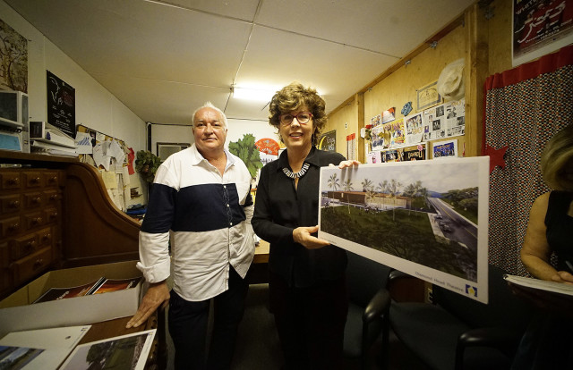 Diamond Head Theatre Executive Director Deena Dray, right, and Head Theatre Artistic Director John Rampage hold an architectural rendition of the proposed new building.