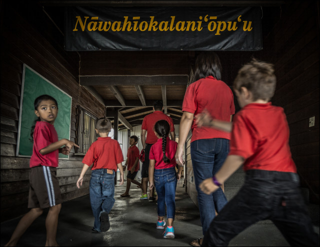Students walk into Nawahiokalani'opu'u Hawaiian Immersion School in Keaau, Hawaii.