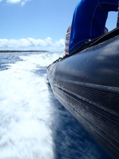 A snorkel tour boat cruises on the south shore of Kauai.