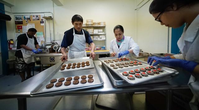 River of Life Chocolate. Left to right, , Norman Siales, Joseph Chun, right Chocolatier Ana Sagadraca with right, daughter Katrina Sagadraca. 28 jan 2016. photograph Cory Lum/Civil Beat
