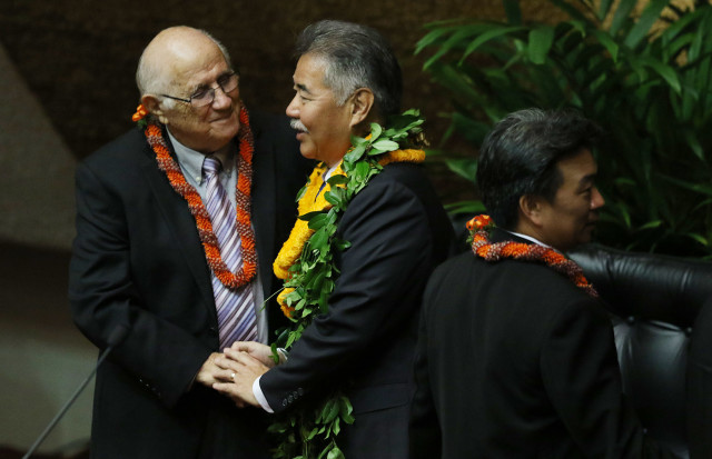 Gov. David Ige, seen here last month after he delivered his State of the State, has called on Speaker Joe Souki, pictured at left, and Senate President Ron Kouchi to expedite passage of a bill to help cool public school classrooms.
