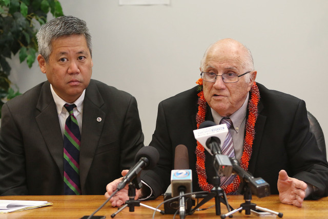 House Majority Leader Scott Saiki, left, and House Speaker Joe Souki meet with reporters in the speaker's conference room after the State of the State.