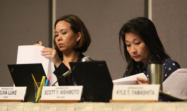 Senate Ways and Means Chair Jill Tokuda, left, and House Finance Chair Sylvia Luke listen to Finance Director Wes Machida (not pictured) share the administration's fiscal 2017 budget proposal at the Capitol auditorium, Monday.