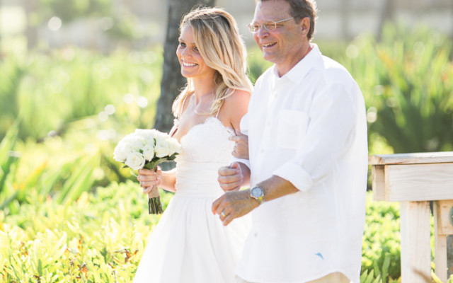 Corey Schlossman walks his daughter down the aisle at a wedding on Kauai, two days before he drowned there.