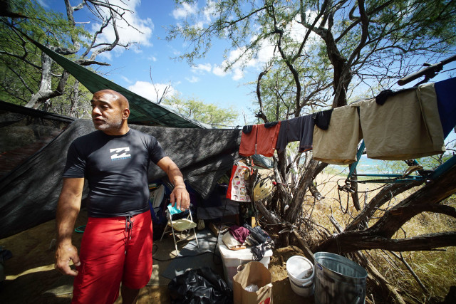 Allan Tang lives in a tent with Kelley along Diamond Head slopes. Denby Story.