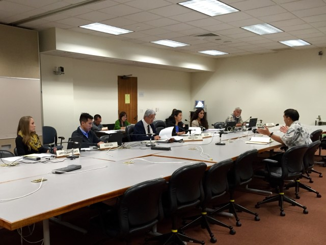 Hawaii State Ethics Commission Executive Director Les Kondo, right, testifies before the House Higher Education Committee, chaired by Rep. Isaac Choy, Tuesday.