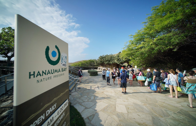 Visitors form a quick moving line at the entrance Hanauma Bay Nature Reserve.