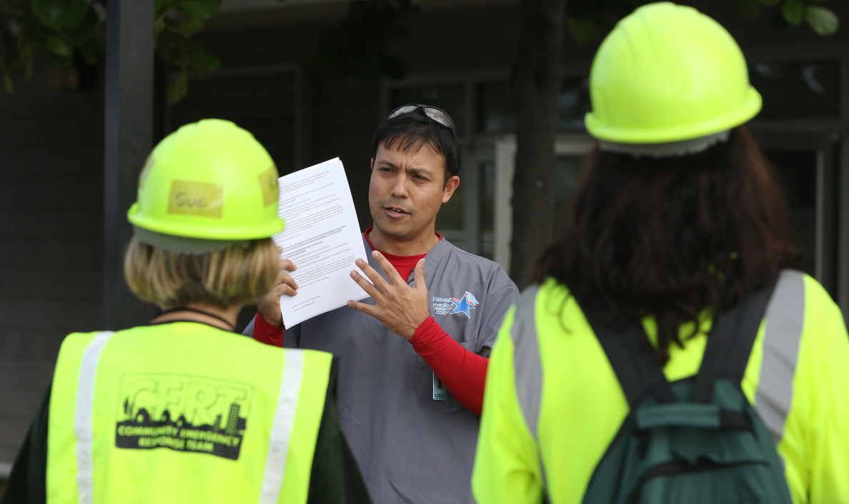 Jason Dela Cruz Dept of Health speaks to CERT crews, nurses and other volunteers in Kailua Kona regarding handing out information and OFF bug repellant.
